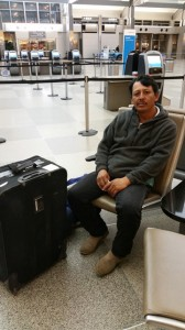 Jose waiting at the airport for his flight home to Mexico.